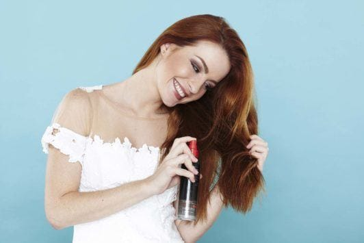 girl with red hair spray sea salt spray