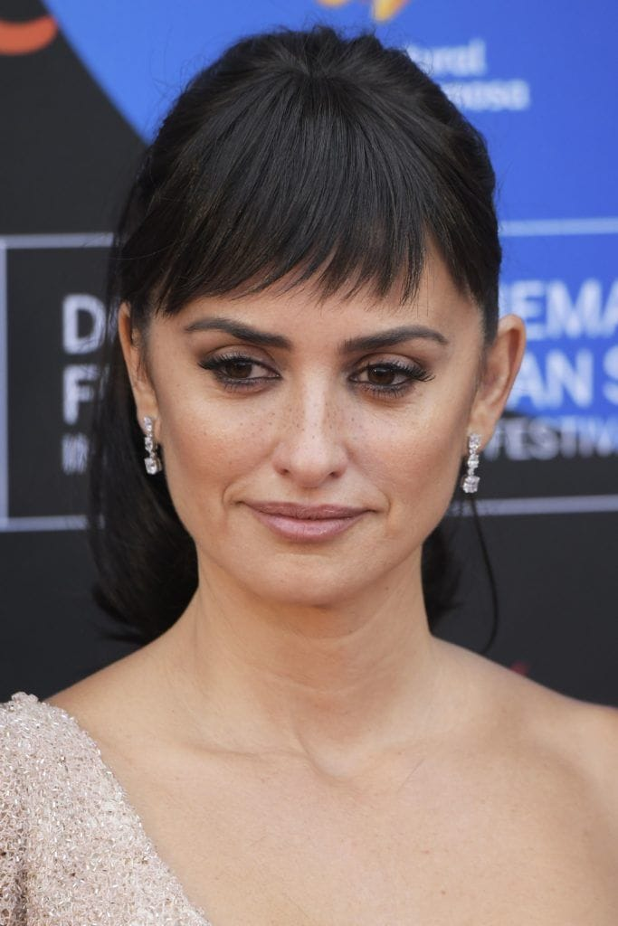 Penelope cruz with her hair in a ponytail and a fringe hairstyle