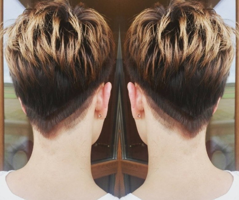 Short ombre hair: Woman with pixie cut with ombre ends and undercut at the nape of the neck.