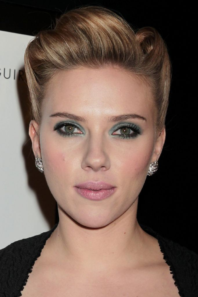 Scarlett Johansson with green eyeshadow and pink lipstick and a rockabilly hairstyle