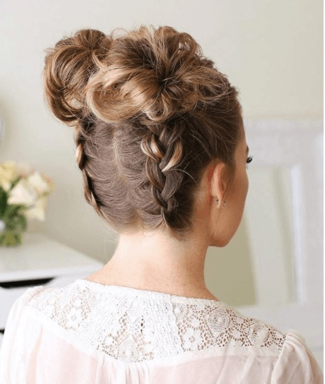 back view of a woman with upside down dutch braids and buns