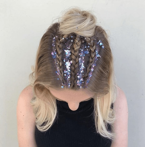 image of a woman with long blonde hair in braids with glitter roots - braid hairstyles 2017
