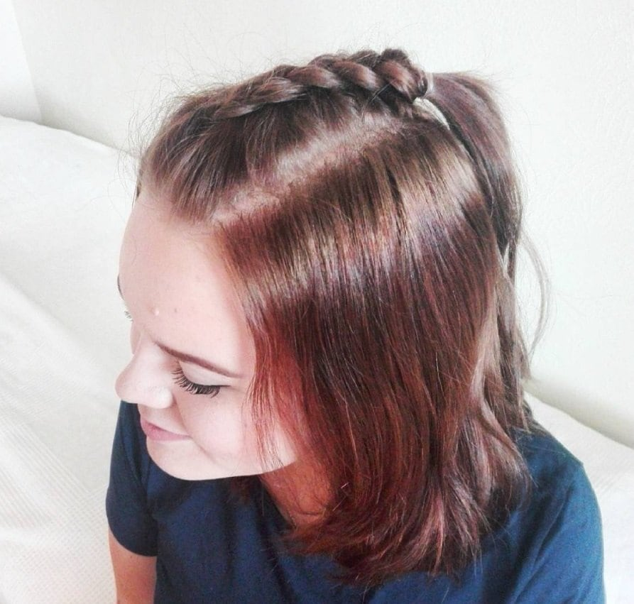 hairstyles for school short hair: short haired redhead with a unicorn braid down the centre of her head