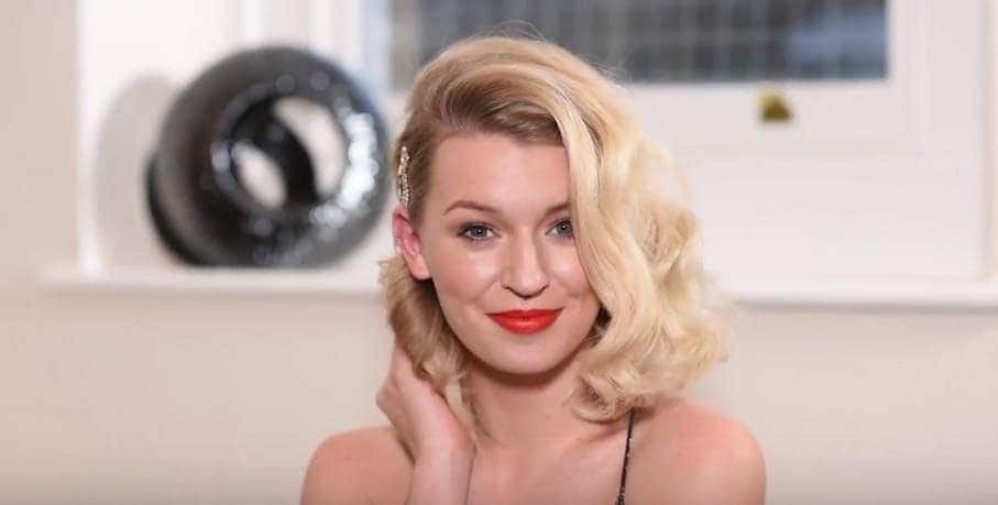 Prom hairstyles for short hair: Blogger Zoe Newlove with her blonde bob hair in 1950s inspired coiffed curls with a glitzy hairclip.