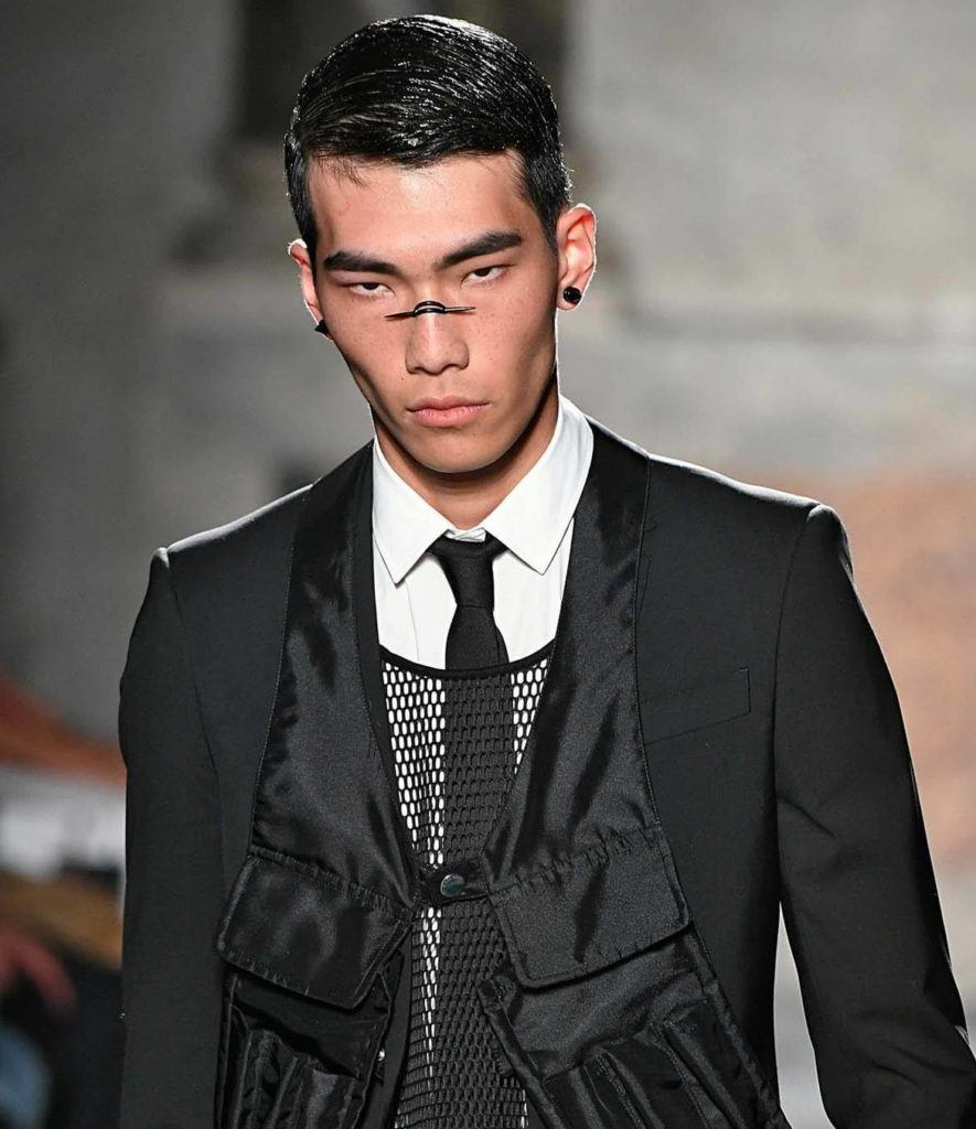 front view image of a male model with black wet look hair