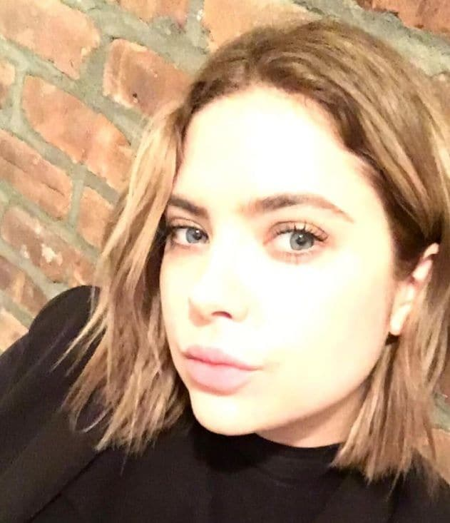 close up shot of ashley benson with bronde hair colour and short bob haircut, wearing all black