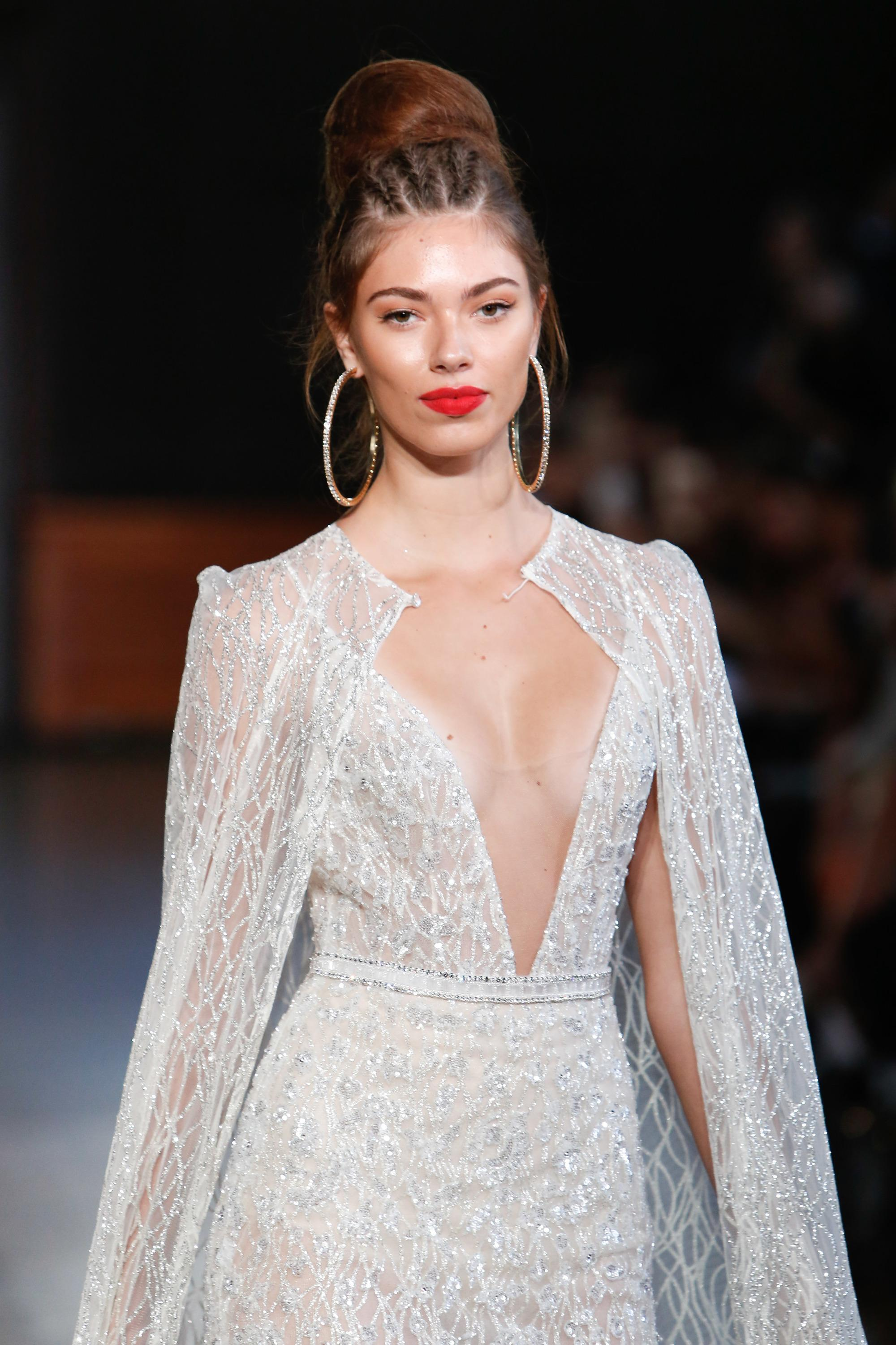 woman on the runway at bridal fashion week with a braided bun