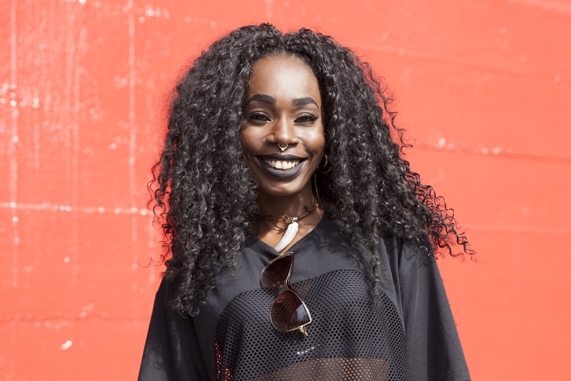 african hair braiding: crochet braids as demonstrated by this model with curly black hair