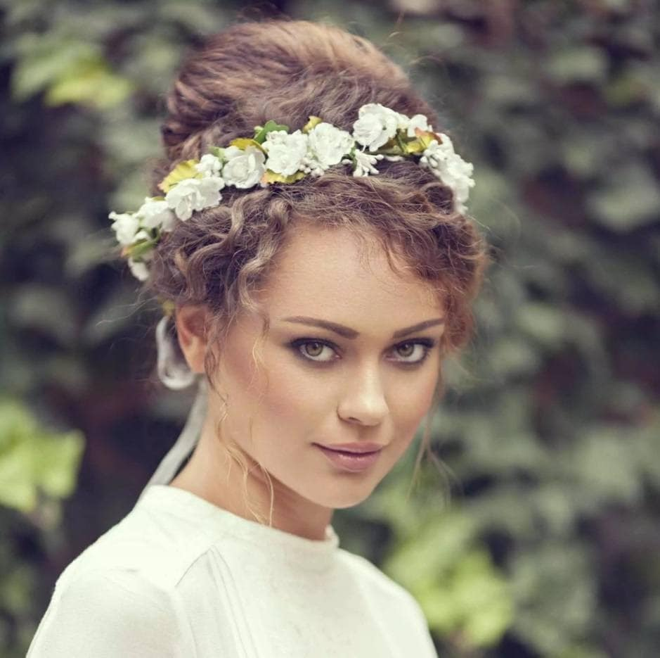 bridal model with brunette curly hair in a bun hairstyle