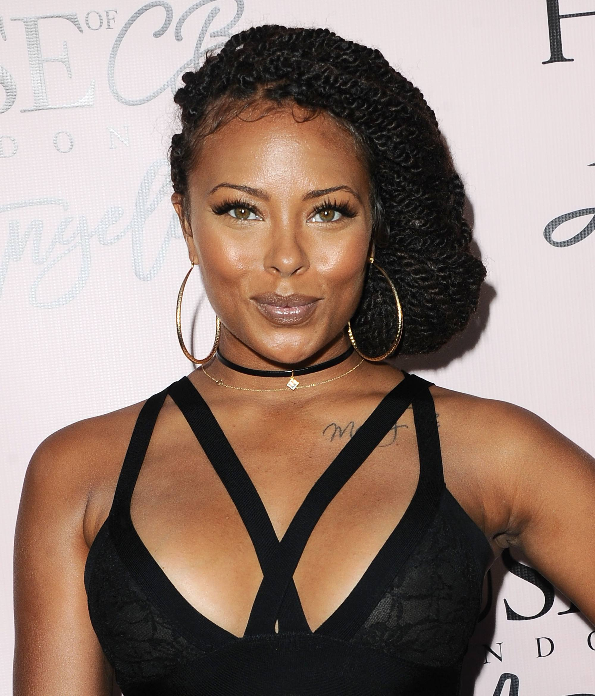 eva marcille individual braids styled into a side tuck