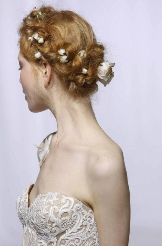 strawberry blonde bridal model with her hair in a delicate floral updo