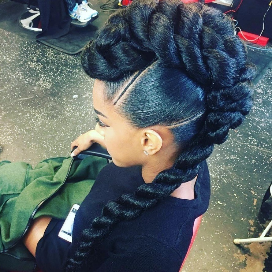 woman with giant braided mohawks