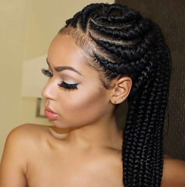 black woman with goddess braids in a ponytail