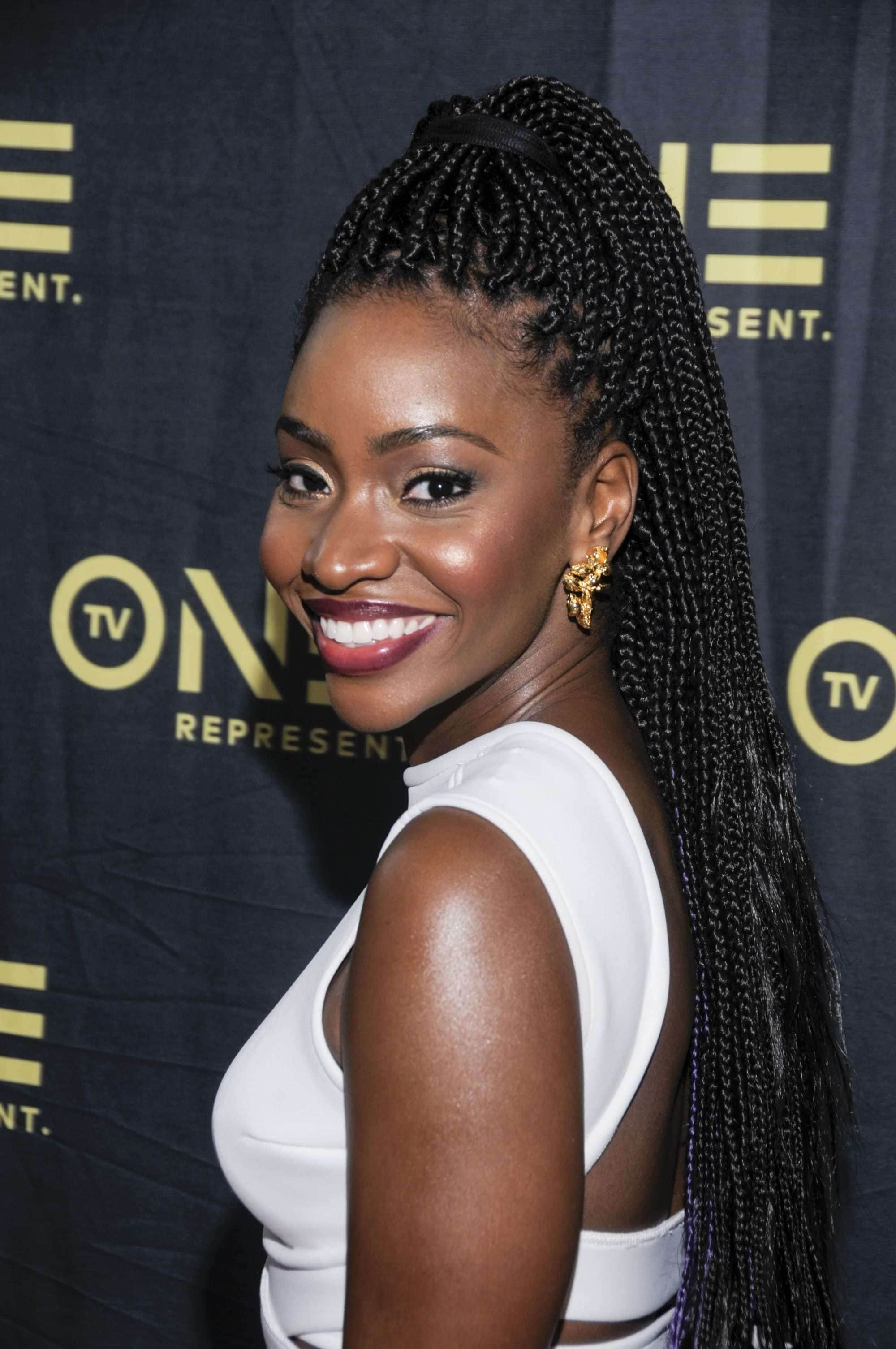easy micro braid hairstyles: Teyonah Parris with half up half down braided hairstyke