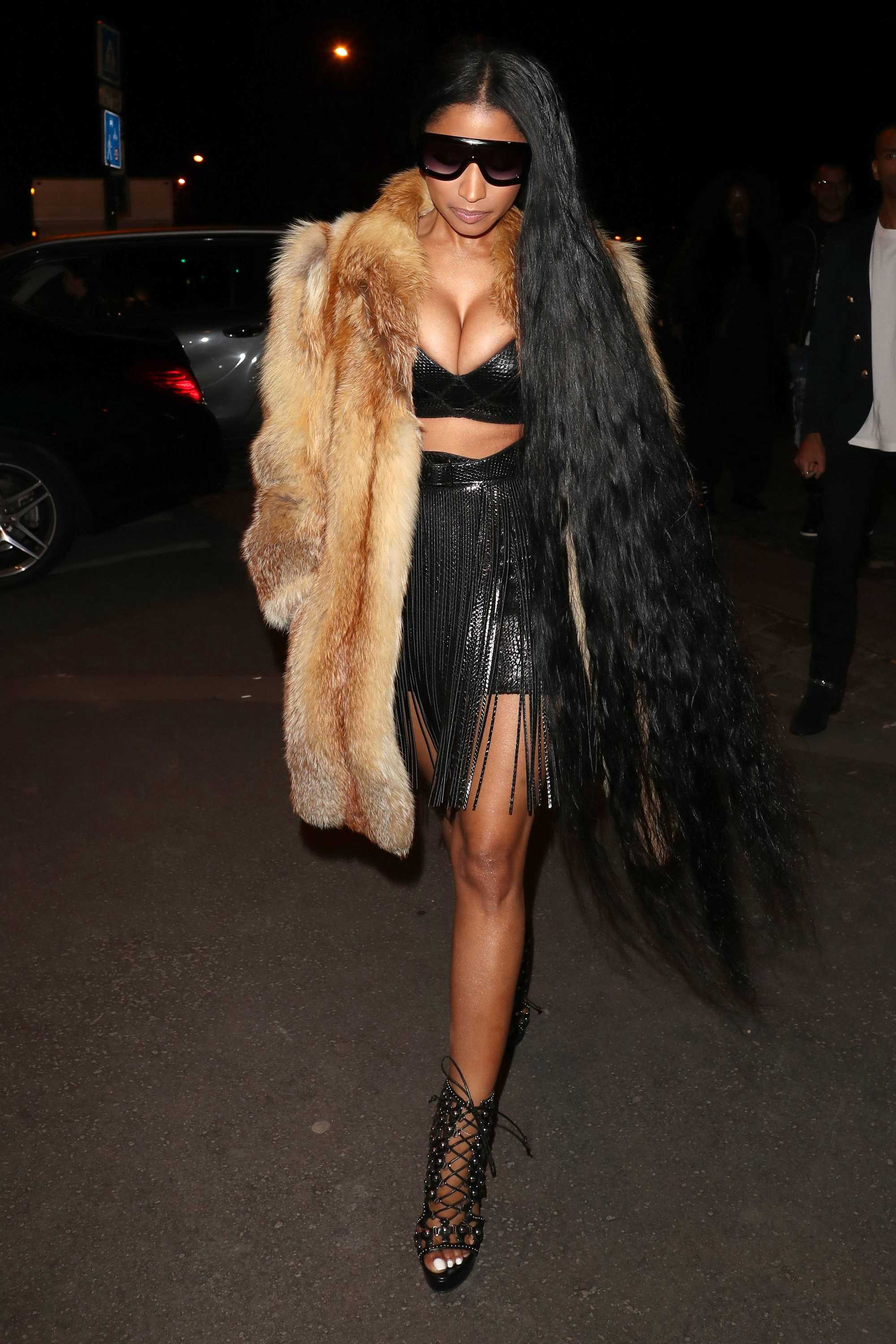 nicki minaj with really long hair, fur jacket wearing all black street style shot