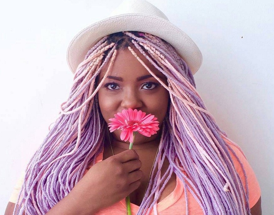 colourful micro braid hairstyles images: Amina Mucciolo with pastel coloured braids