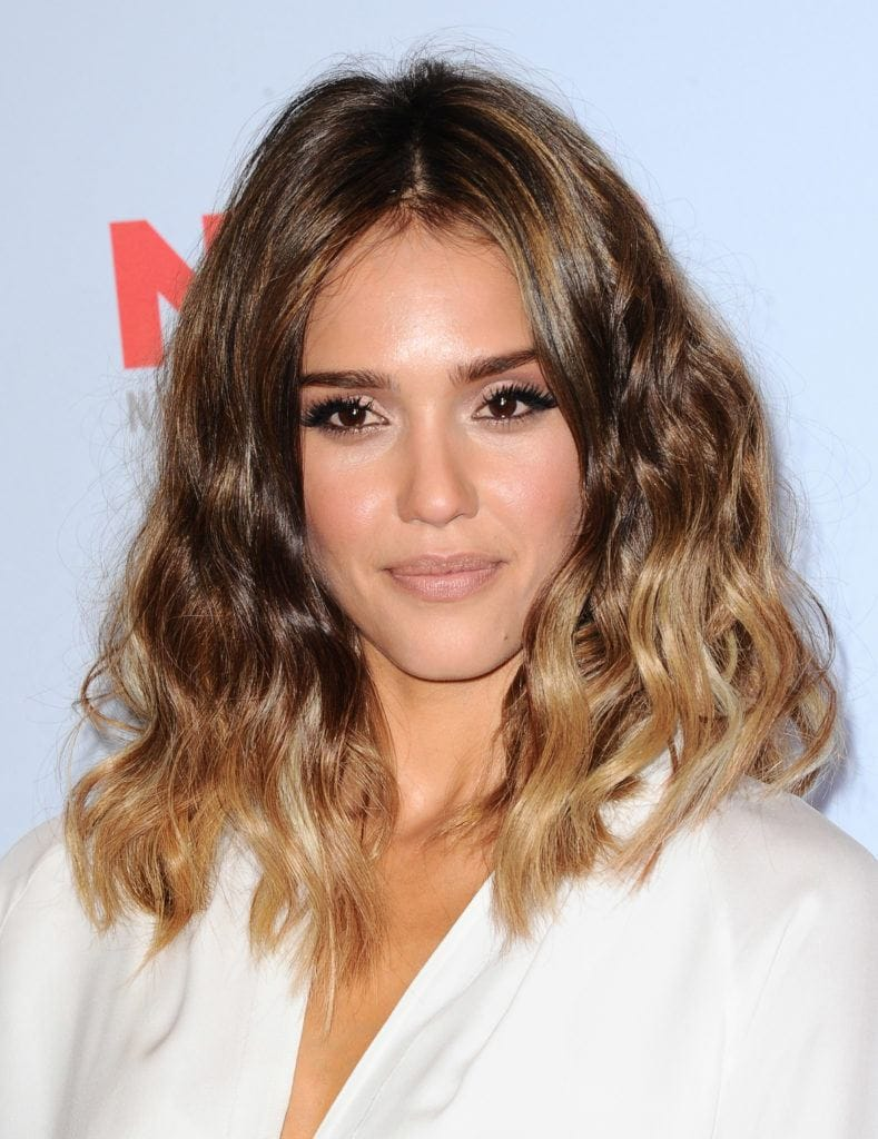 front view of Jessica Alba with shoulder length wavy hair with a subtle ombre: Credit: Rex by Shutterstock