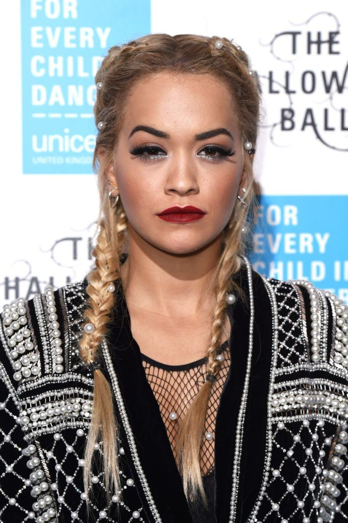 rita ora with a french 2 braids hairstyle embellished with pearls