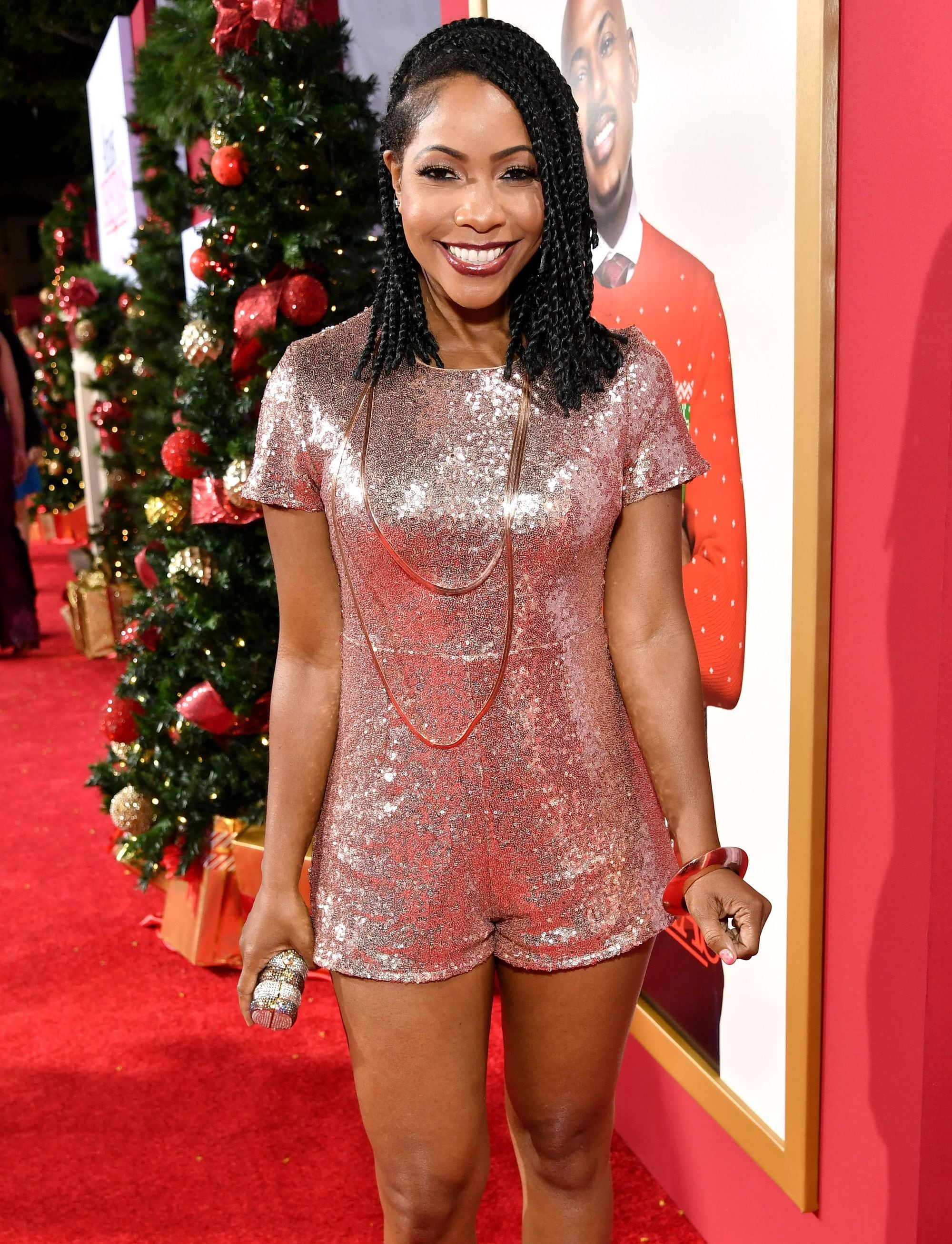 short kinky twist styles: shadia omar with lob kinky twists wearing sparkly playsuit on red carpet