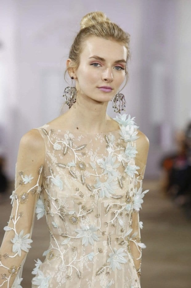 blonde bridal model on the runway with a simple updo hairstyle