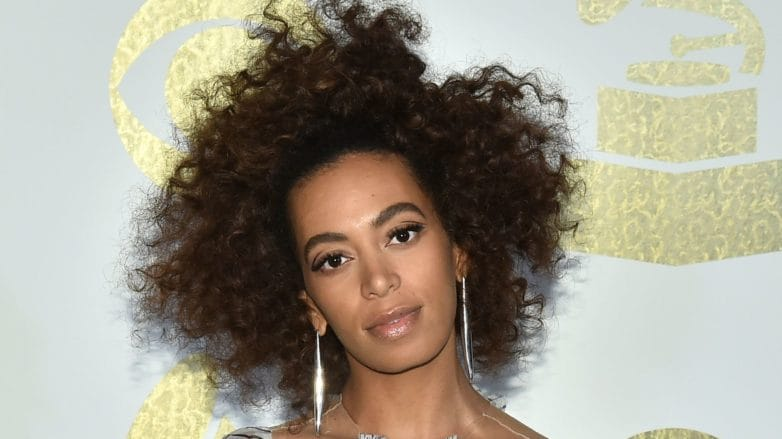 Solange Knowles at the grammys with dark brown afro hair
