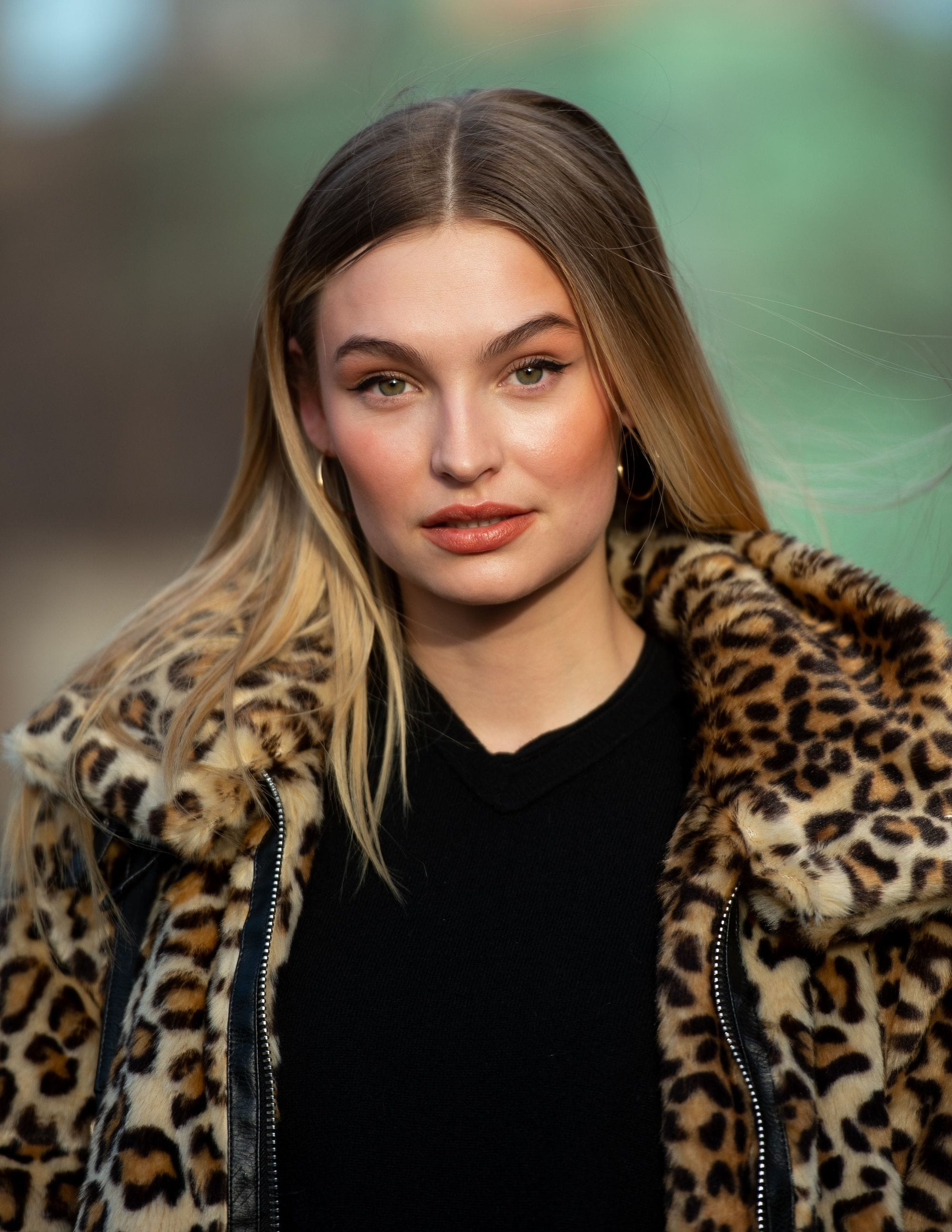 Spring hair colours: Shot of model with brown to blonde melt hair, wearing leopard print jumper wearing black top