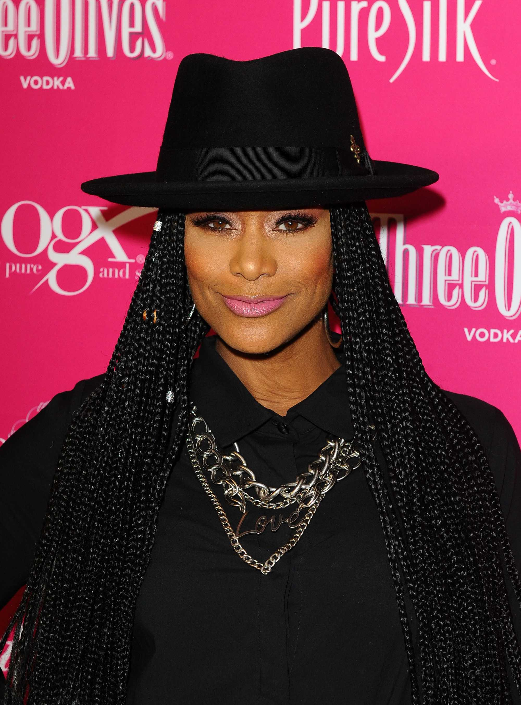 tami roman rocking poetic braids with black hat and hair cuffs