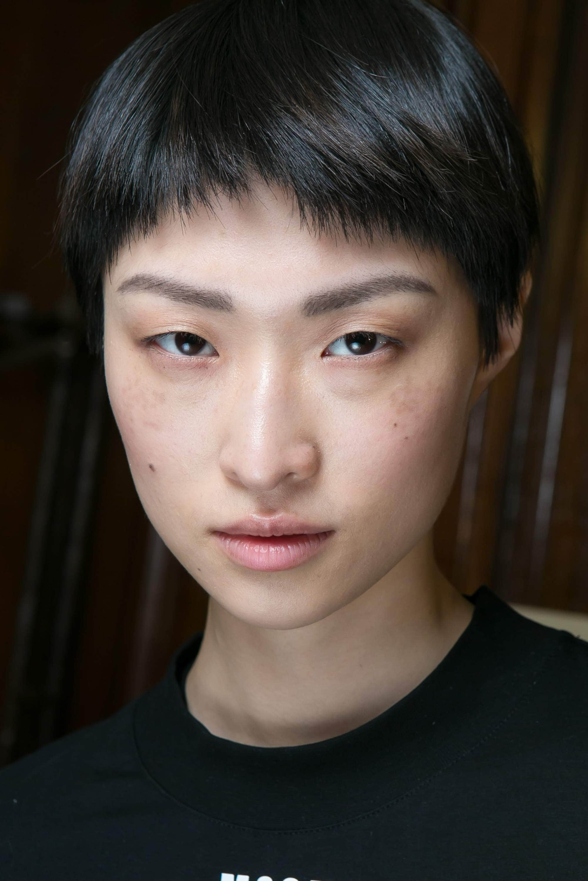 images of short haircuts: a fashionable pixie cut as shown by model backstage