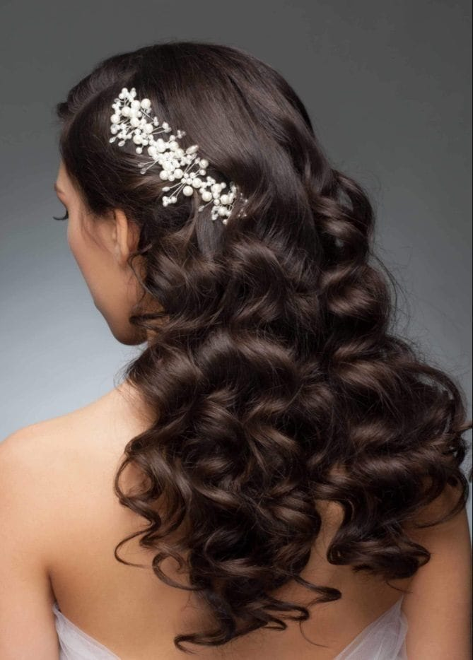 brunette model with wavy long hair with a glitzy hair accessory