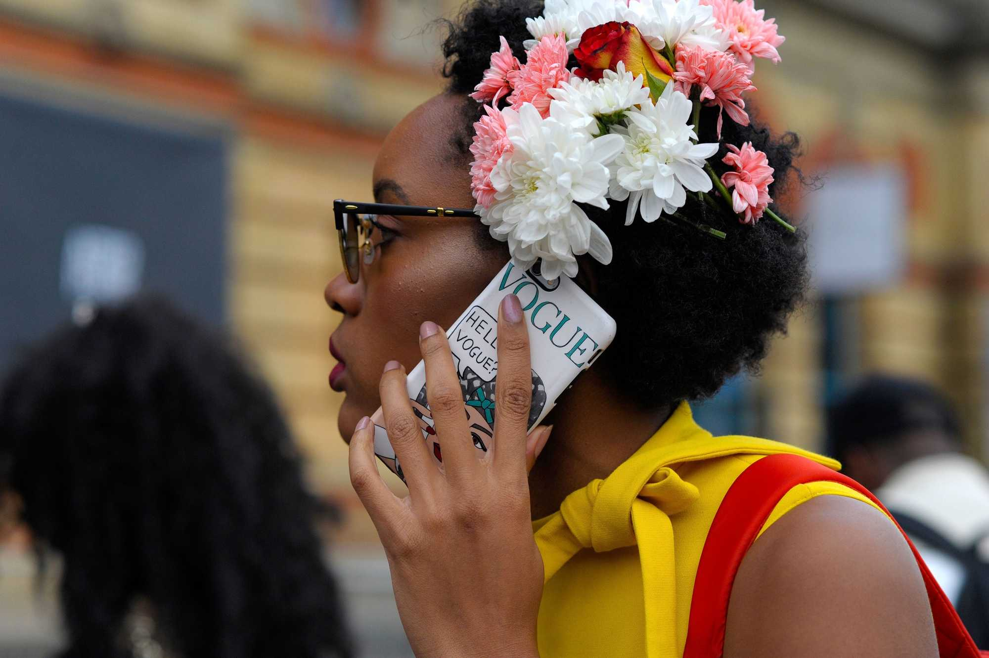 woman with afro hair with flowers for coachella