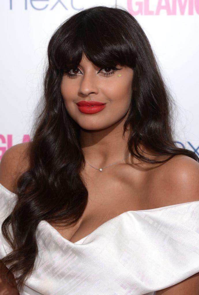 Jameela Jamil with long dark hair in a modern shag hairstyle - long hairstyles 2017