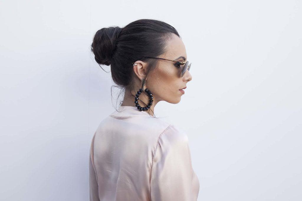 model with long hair 2017 styled into a polished bun