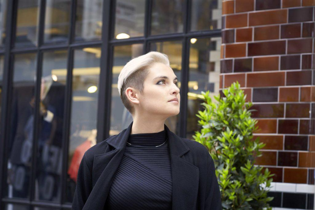 blonde model with a shaved undercut hairstyle
