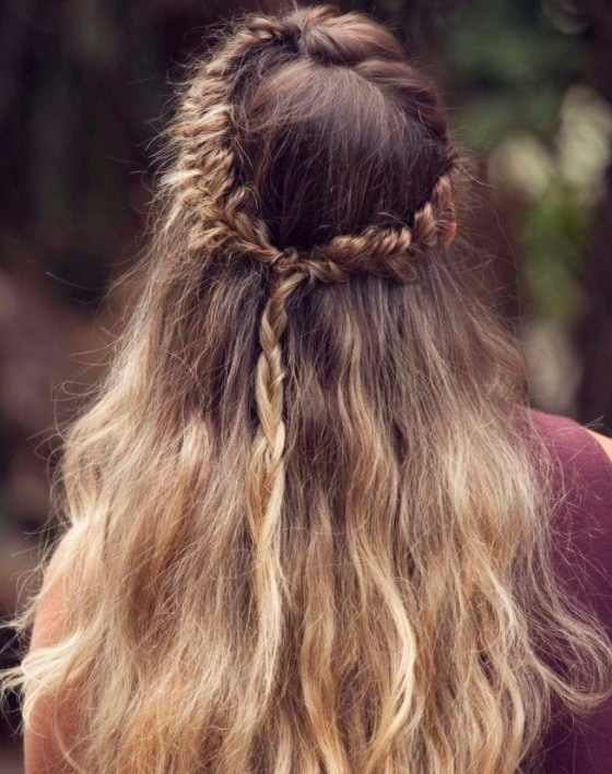 back view image of a woman with a fishtail crown hairstyle
