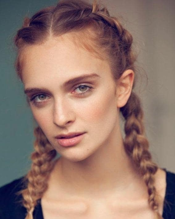 front view image of a woman with blonde hair and pigtail braids