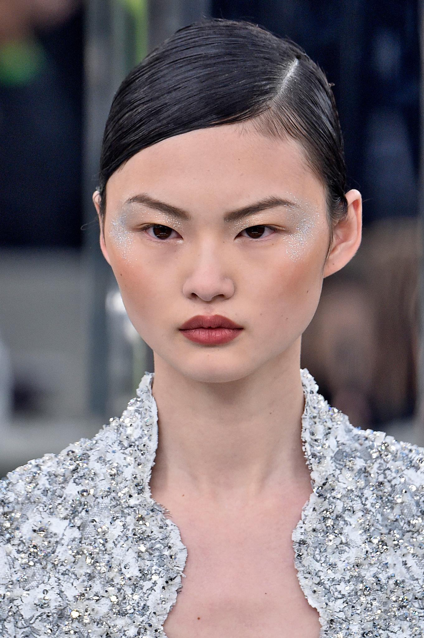 Asian model with deep side parting on runway Chanel SS17