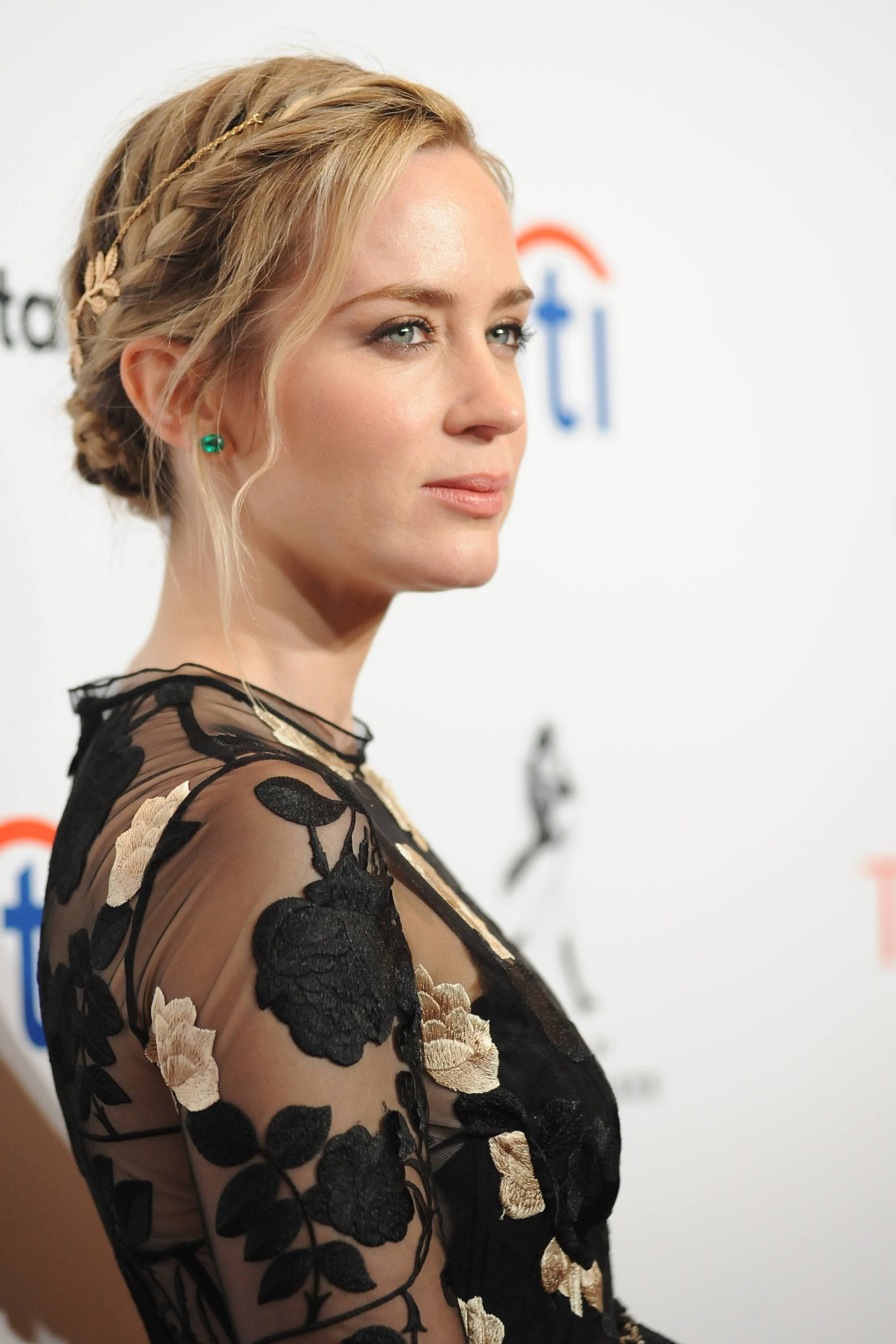 actress emily blunt on the red carpet at the time 100 gala with her honey blonde hair in a braided updo