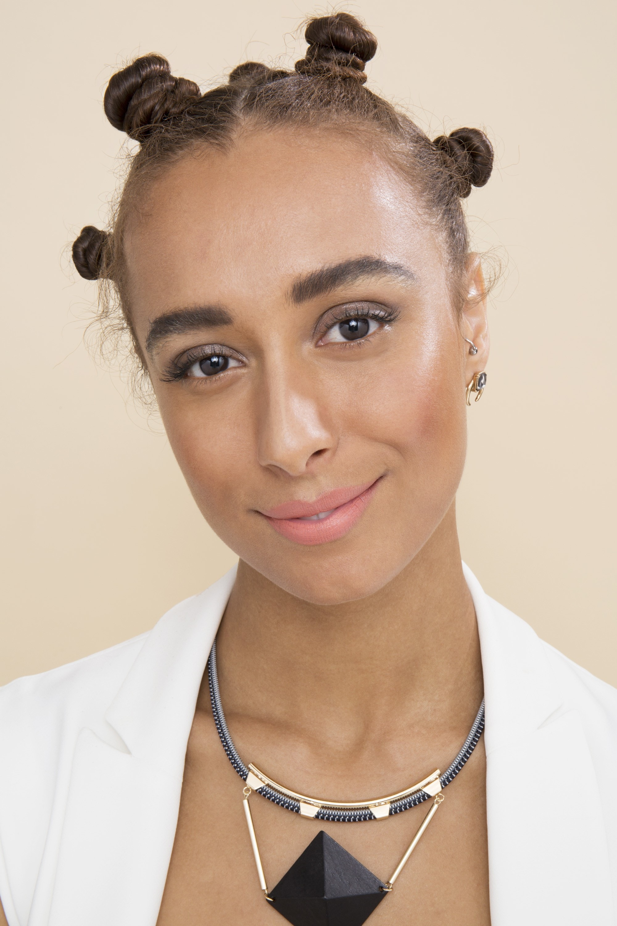 Bantu knots - close up of model with brown hair and bantu knots in final look for tutorial