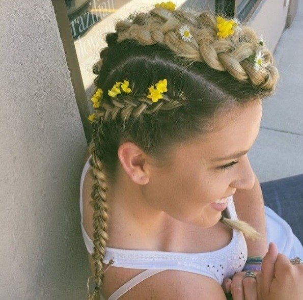 woman with mohawk braids with yellow flowers in