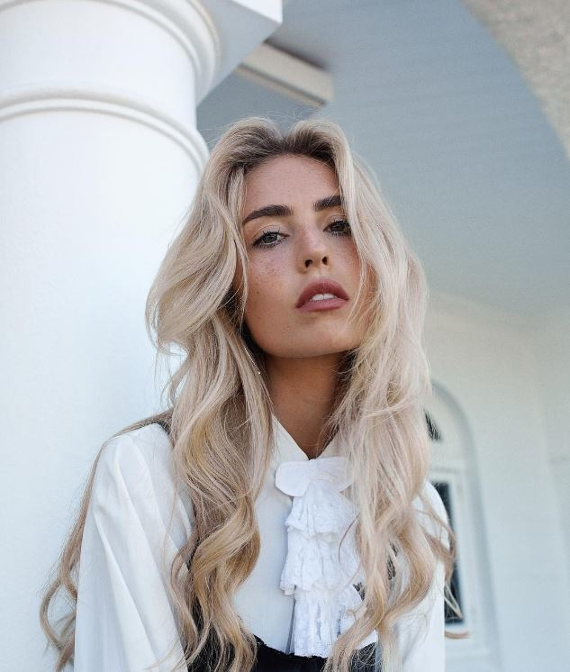 front view image of a woman with loose waves and long blonde hair - Instagram