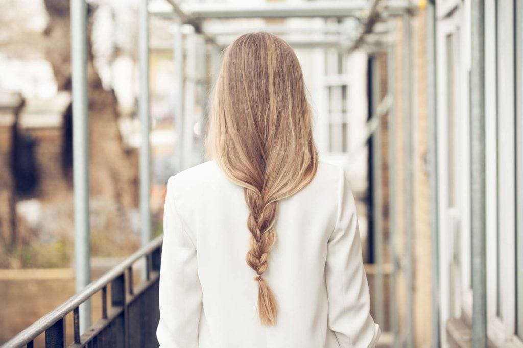 back view image of a woman with a long loose braid hairstyle - long hairstyles 2017