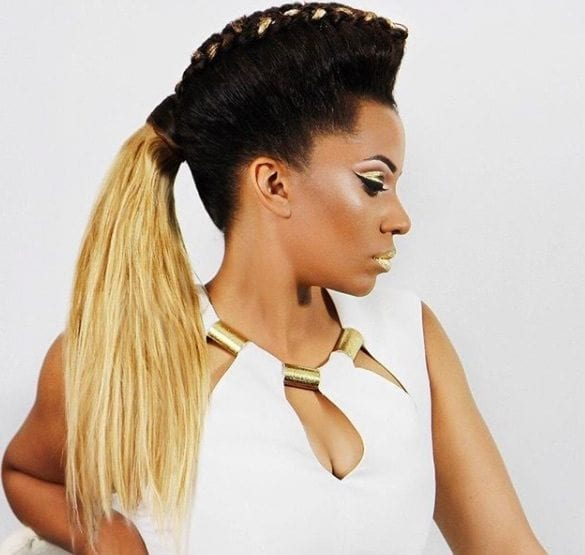 side view of a woman with an ombre hairstyle and a braided mohawk