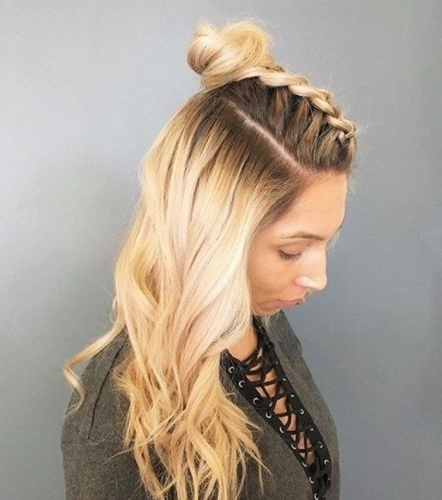side view of a woman with long blonde hair and a hun braid hairstyle