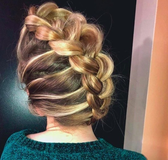 back view of a woman with a mohawk braid blonde up do