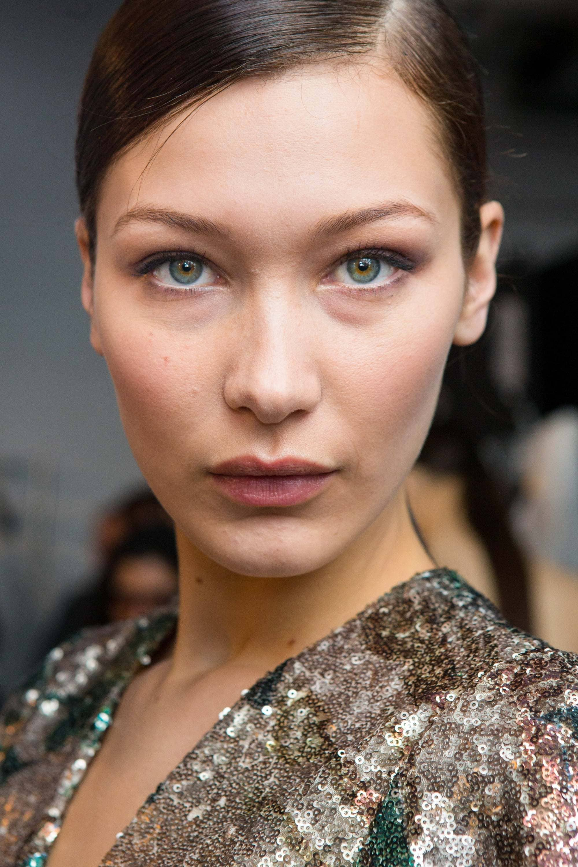 close up of Bella Hadid backstage with deep side parting hairstyle