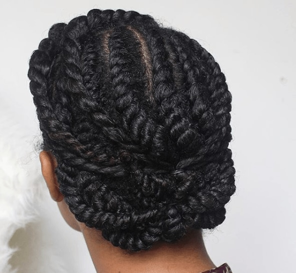 back view image of a woman with her hair in a twisted up do - long hairstyles 2017