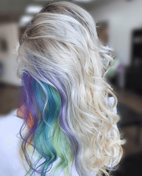 back view image of a woman with long blonde hair and a secret rainbow - long hairstyles 2017