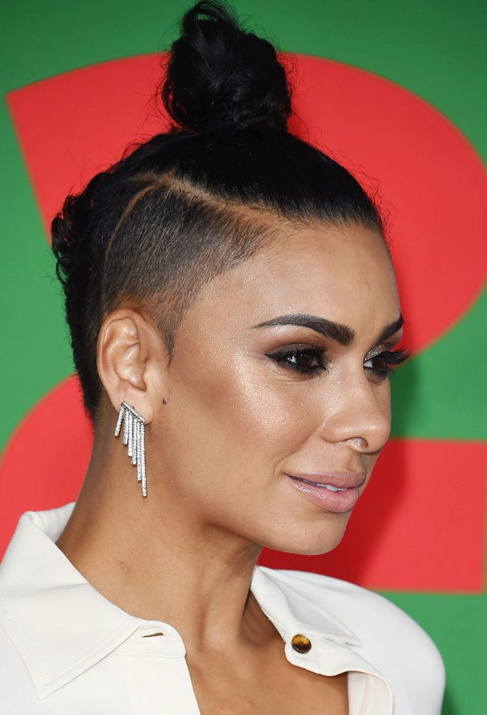 Laura Govan with a shaved undercut and dark black bun - androgynous haircuts