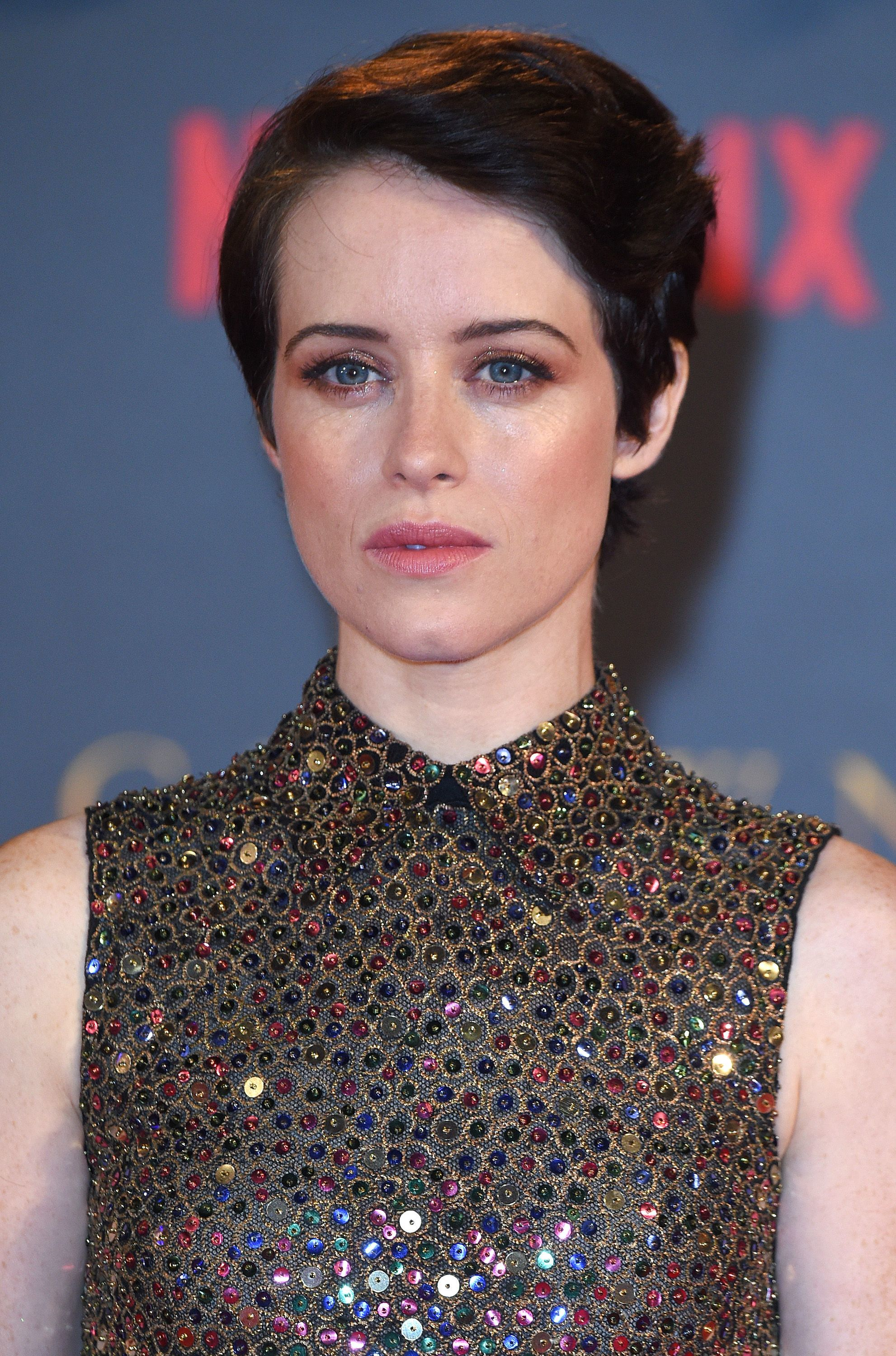 Claire Foy with short dark hair in a side sweep - androgynous haircuts