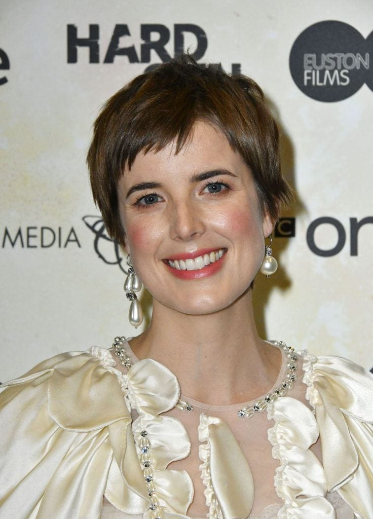 Agyness Deyn with brown hair in a short and choppy style